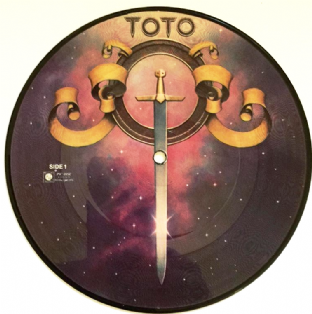 "Toto - Hold The Line/I'll Supply The Love (7"") (Picture Disc) (G/EX)"